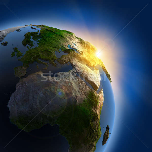 Stock photo: Sunrise over the Earth in outer space