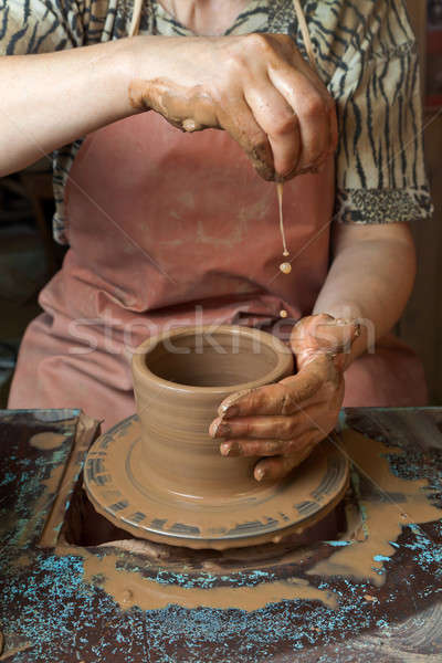 Potter creates a pitcher on a pottery wheel Stock photo © Antartis