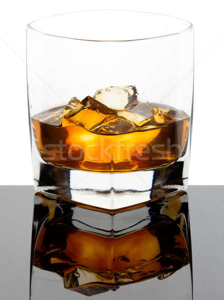 Glass of whiskey with ice cubes Stock photo © Antartis