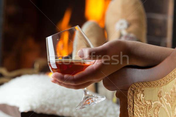Brûlant cheminée feu verre cognac Photo stock © Antartis