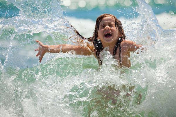 Petite fille mer rire pleurer spray Photo stock © Antartis