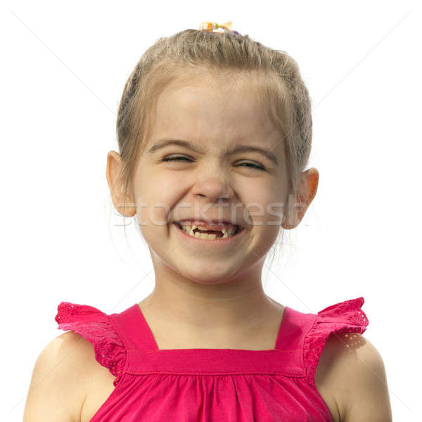 Little girl with milk teeth dropped out Stock photo © Antartis