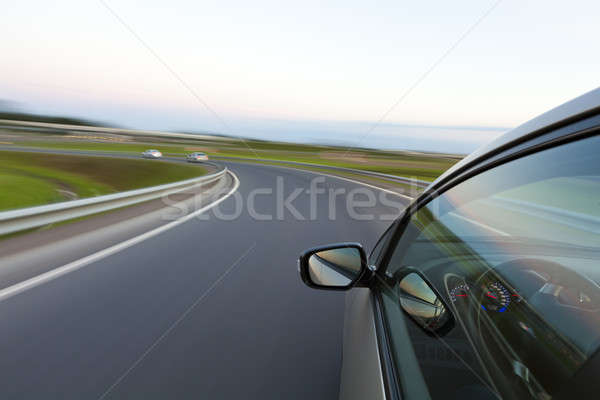Car goes very fast to turn a country road Stock photo © Antartis