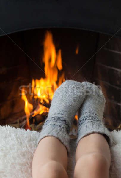 Ayaklar şömine sıcak yün çorap yangın Stok fotoğraf © Antartis