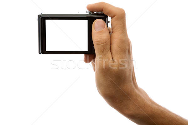 Photo camera in hand isolated on white Stock photo © Antartis