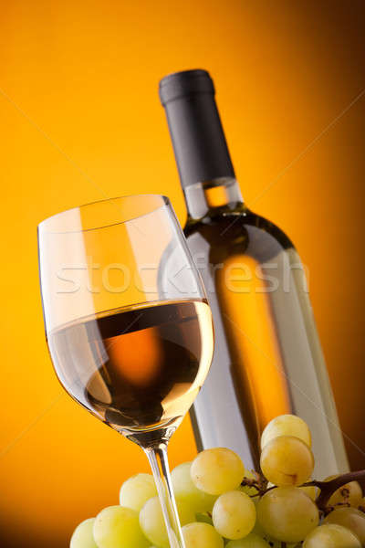 Bottom view of a glass of white wine bottle and grapes  Stock photo © Antartis