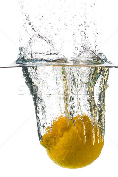 Citron relevant eau spray blanche alimentaire Photo stock © Antartis