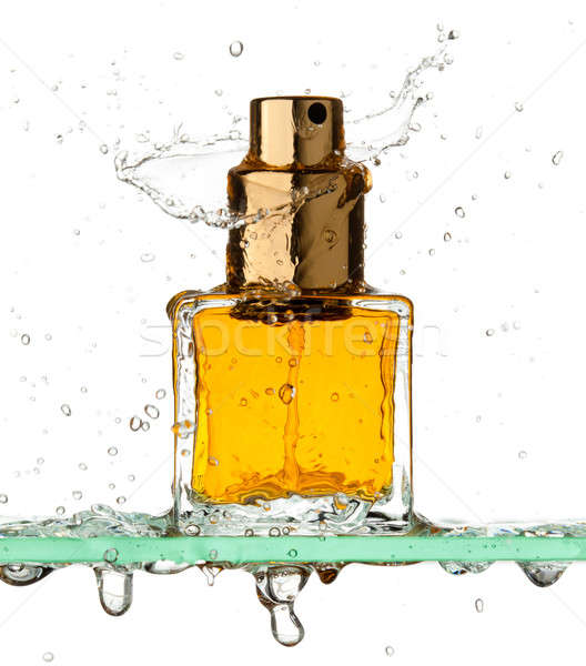 Bottle of perfume in a spray of water Stock photo © Antartis
