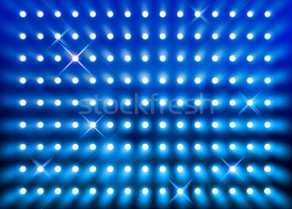 Sparkling blue spotlight wall Stock photo © Anterovium