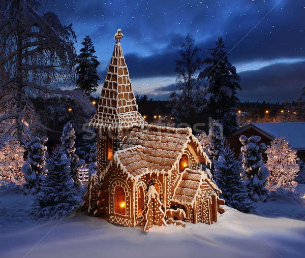 Gingerbread church on snowy Christmas night landscape Stock photo © Anterovium