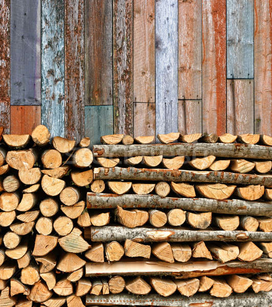 Stacked firewood colorful batten wall Stock photo © Anterovium