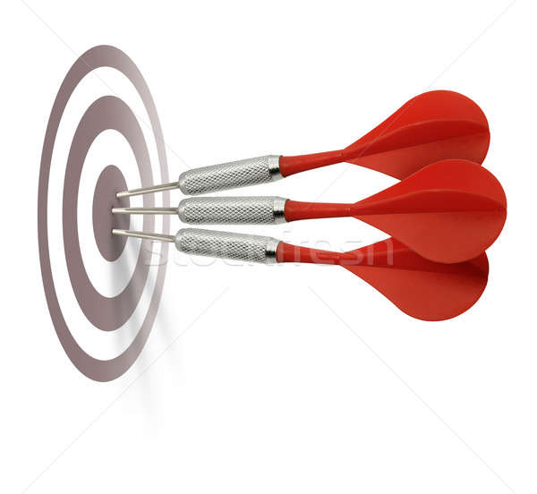 Three red darts hitting target Stock photo © Anterovium