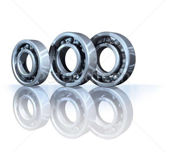 Ball bearings on reflective background isolated Stock photo © Anterovium