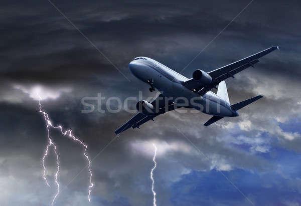 Lucht vliegtuig donder storm bliksem zon Stockfoto © Anterovium