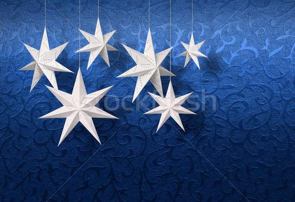 White paper stars on blue brocade Stock photo © Anterovium