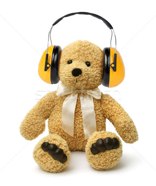 Teddy bear sitting with hear protectors Stock photo © Anterovium