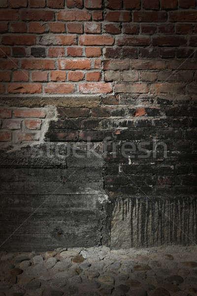 Téglafal beton kövek sötét tégla fal Stock fotó © Anterovium