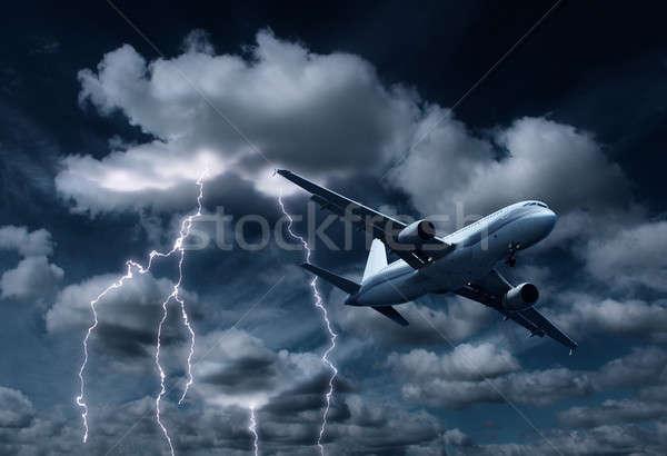 Uçak sağanak gökyüzü bulutlar mavi fırtına Stok fotoğraf © Anterovium