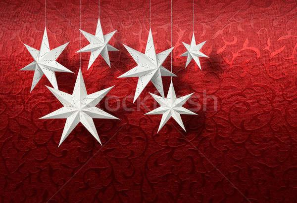 White paper stars on red brocade Stock photo © Anterovium