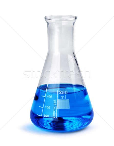 Labotatory glass beaker with blue liquid sample Stock photo © Anterovium