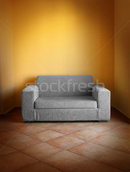 Gray sofa yellow wall Stock photo © Anterovium