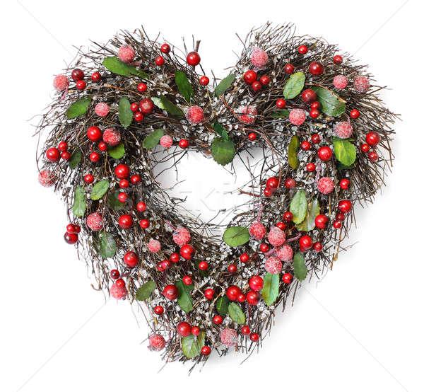 Heart shaped Christmas garland on white background Stock photo © Anterovium