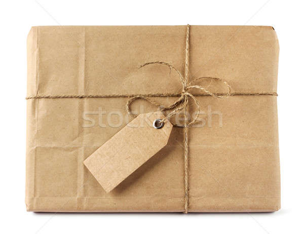 Brown mail delivery package with tag Stock photo © Anterovium