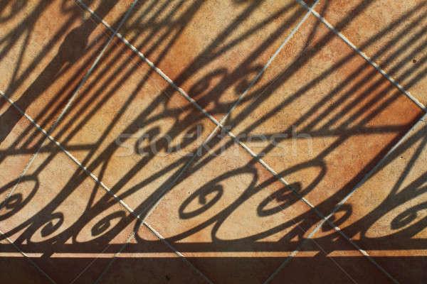 Shadows on tiled patio Stock photo © Anterovium