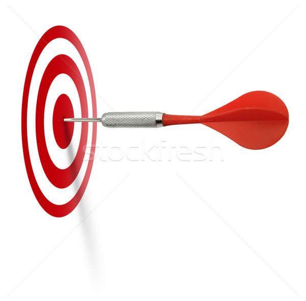 Red dart hitting target Stock photo © Anterovium