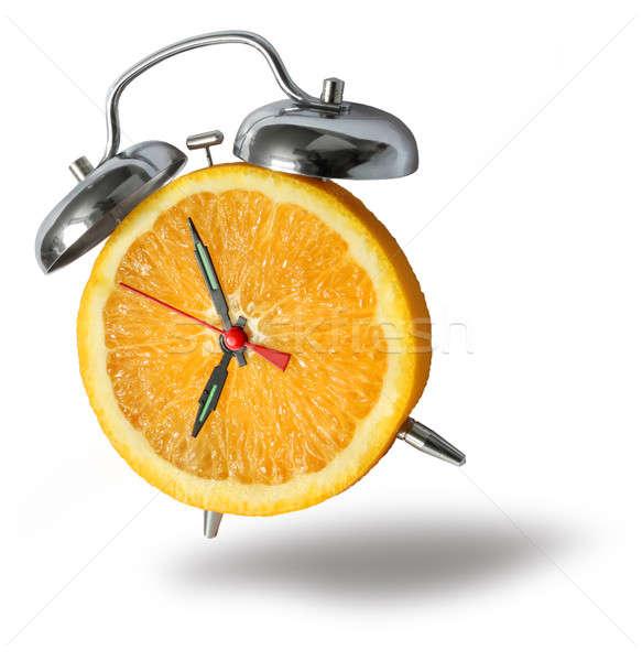 Narancs ébresztőóra friss narancs arc óra Stock fotó © Anterovium