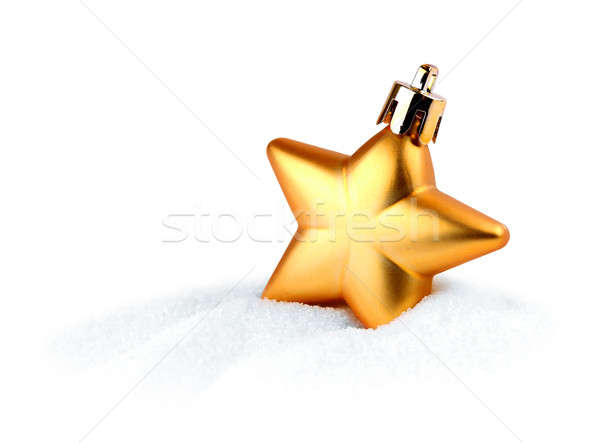 Golden Christmas star in snow Stock photo © Anterovium