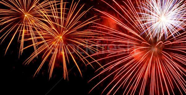Tűzijáték szélesvásznú piros citromsárga sötét éjszakai ég Stock fotó © Anterovium