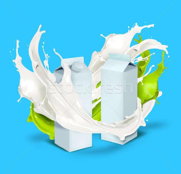 свежее молоко белый зеленый всплеск изолированный синий Сток-фото © Anterovium