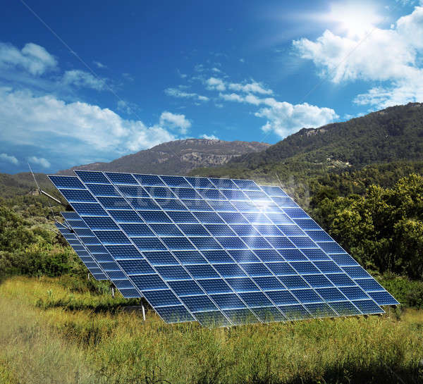 Solar energy panel collectors reflecting sun Stock photo © Anterovium