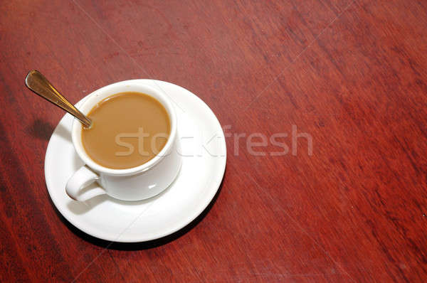 a cup of coffee with creamer Stock photo © antonihalim