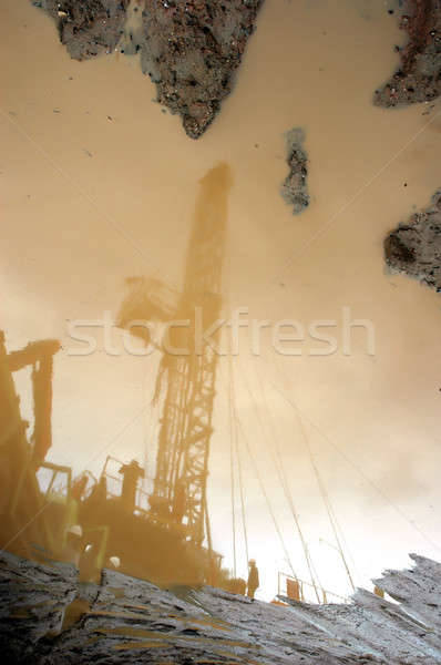 reflection of petroleum miner Stock photo © antonihalim