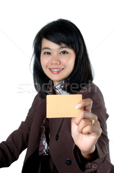 Fiatal üzletasszony mutat üres kártya név izolált Stock fotó © antonihalim
