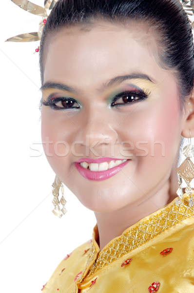 Stock photo: portrait of an asian young girl dressed in traditional indigenous tribal borneo