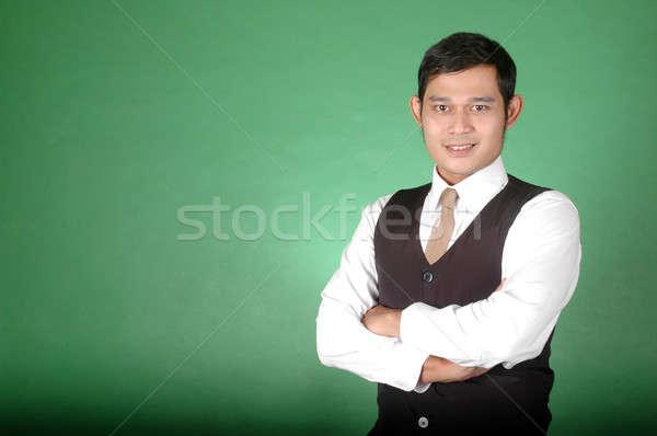 肖像 アジア 若い男 緑 ビジネス 手 ストックフォト © antonihalim