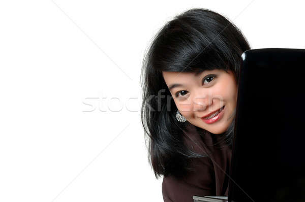 asian young businesswoman peered from behind the laptop  Stock photo © antonihalim