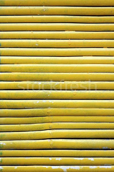 Citromsárga bambusz függöny fa fal absztrakt Stock fotó © antonihalim