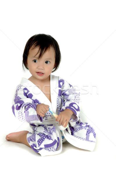 Kislány visel fürdőruha tart fogkefe izolált Stock fotó © antonihalim