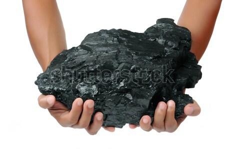 male hand holding a big lump of coal  Stock photo © antonihalim
