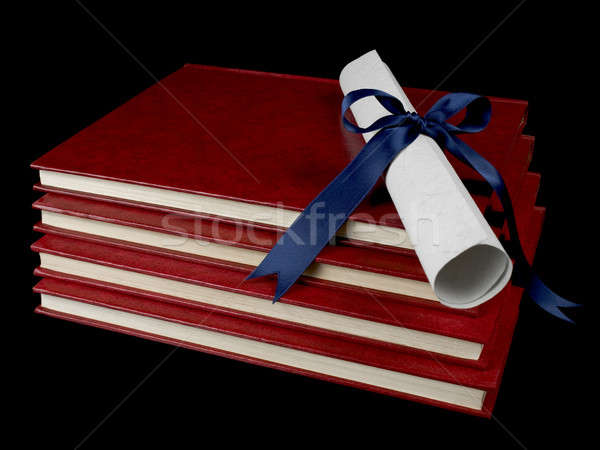 Diploma over books Stock photo © antonprado