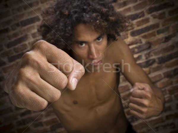 Utca vadászrepülő fiatalember dob ököl kamerába Stock fotó © antonprado