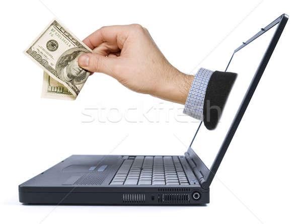 Azonnali viszzafizetés kéz dollár számla laptop Stock fotó © antonprado