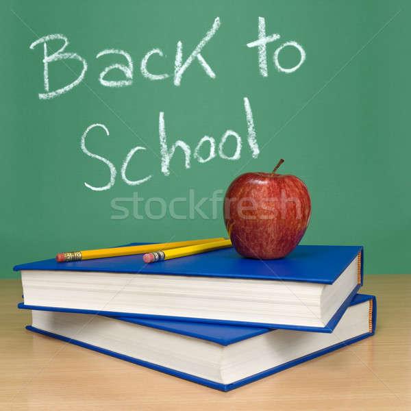 Снова в школу написанный доске книгах карандашей яблоко Сток-фото © antonprado