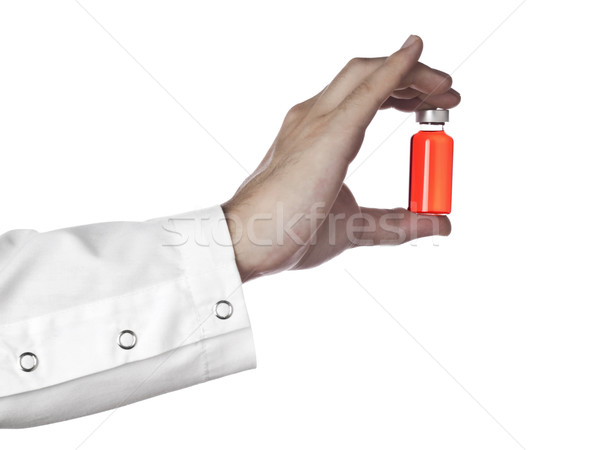 Red vial on a hand Stock photo © antonprado