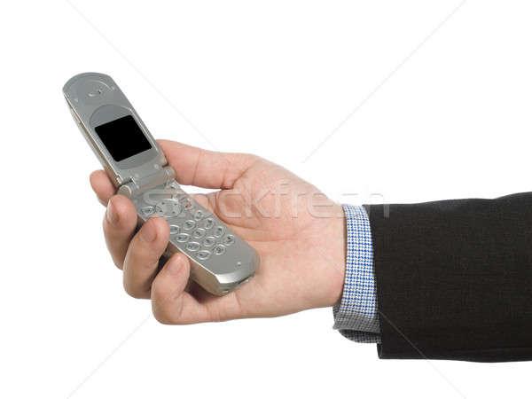 Holding a cell phone Stock photo © antonprado
