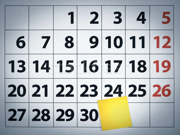 Stock photo: Blank sticky note on a calendar